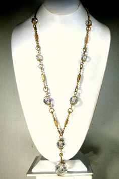 Clear Glass and Gold Victorian Necklace, Crystal Style Dangle Pendant, HANDSOME and Classic, Glass and Metal with Stunning Details LOOK Closely Please, Such Pretty goldtone Detailed beads This necklace is 32 ( 81.28cm ) to the bottom of the large Clear Faceted Glass Ball  All the beads are clear faceted glass the large bottom pendant is 1 ( 2.54cm ) there is some minor chipping on the corner facets Very elegant and classic necklace..timeless too!  USED, Not perfect ( minor chipping on some…