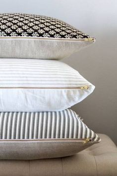Learn how to decorate with taupe and beige. Domino shares ideas for decorating with taupe that aren't boring. For more color trends and interior inspiration, head to Domino. Decor, Soft Furnishings, Taupe Pillow, Striped Bedding, Pillow Design, Pillows, Ticking Stripe, Custom Pillows, Decorative Pillows