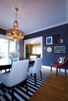 Love the bright white chairs with the dark walls! Interior by Kerrie Kelly.