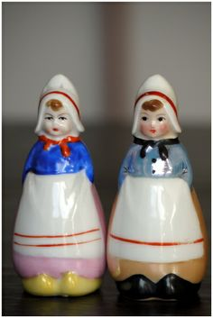 Reminds me of the Dutch girl cookie jar we had when I was a kid. Vintage Dutch Girls Salt and Pepper shakers by Noritake 1920s