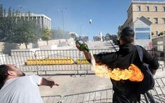 Amateur youth, pitching a leaking Molotov cocktail at the Greek Parliament.