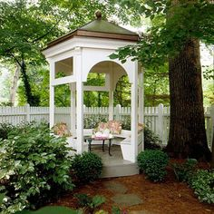 Small-Space Gazebo:  Even the smallest yards can incorporate a gazebo for outdoor dining or as a yard focal point. The small footprint of this copper-roofed structure means it can fit just about anywhere. Built-in bench seating provides plenty of places to sit.