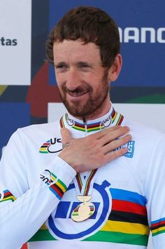 New world champion Britain's Bradley Wiggins gestures on the podium after winning the men's individual time trial event over 47.1 kilometers (29.3 miles) at the Road Cycling World Championships in Ponferrada, north-western Spain, Wednesday Sept. 24, 2014. Photo: Daniel Ochoa De Olza, AP / AP