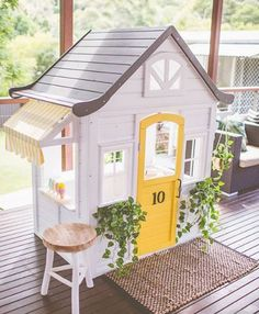 little greenery and a bright yellow door makes this Kmart cubby house hack pop!A little greenery and a bright yellow door makes this Kmart cubby house hack pop! Kids Cubby Houses, Kids Cubbies, Play Houses, Backyard Playground, Backyard For Kids, Kmart Home, Kmart Decor, Wendy House, Diy Playhouse