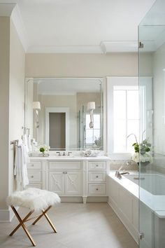 White And Tan Master Bathroom Boasts A Single White Washstand With X Front  Cabinets And White