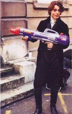 """Johnny Depp's got a gun. Taken on the set of """"Sleepy Hollow"""""""