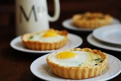 Baked egg breakfast cups with bacon, spinach and cheese