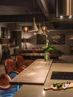 Dutch brand Moooi provided concrete light pendants that hang over the kitchen work top in the show apartments at Concord House in Marshall Street, Birmingham.