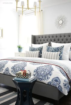 Blue and white Summer decorated bedroom with layers of bold pattern - batik, stripes and paisley - bring a casual, coastal look. Upholstered headboard with nailhead trim is classic and elegant. Light blue walls keep the look crisp and airy. Blue Bedroom Paint, Blue Bedroom Decor, Bedroom Colors, Paisley Bedroom, Bedroom Ideas, Home Interior, Interior Design, Modern Interior, Coastal Bedrooms