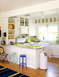 Vintage Cooking - A beach house kitchen offers retro appeal without sacrificing modern conveniences - Although this home is new, its blue-and-green color scheme and vintage beach-house vernacular makes it seem decades old. Open Kitchen, Kitchen Dining, Kitchen Decor, Kitchen Layout, Kitchen Ideas, Vintage Cooking, Vintage Kitchen, Whimsical Kitchen, Eclectic Kitchen
