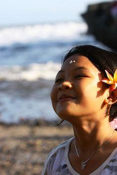 Young girl on the beach smiling, Bali, Indonesia #Bali #Balinese #PeopleofBali #Travel #Culture #Holiday #Villa #Accommodation #Pecatu #Uluwatu #Bukit #Hindu www.villaaliagungbali.com