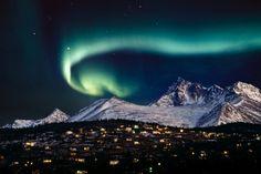 Aurora Borealis over hillside neighborhood & Chugach Mountains Anchorage Alaska