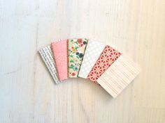 perfect for V-Day:  sweet set of 6 Tiny Journals / by ordinaryartists