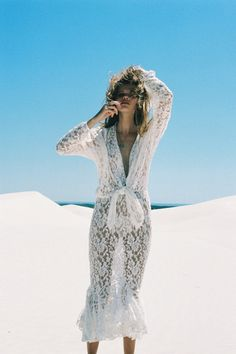 Super sexy feminine cut out lace maxi dress beach cover up, perfect for a modern hippie summery look. For the BEST Bohemian fashion trends FOLLOW http://www.pinterest.com/happygolicky/the-best-boho-chic-fashion-bohemian-jewelry-gypsy-/ now