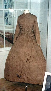 Dress worn by Mrs. Beach during Civil War service as nurse.  Typical work dress of calico print.  Blood stains on front, collection of Mr. Synnamon