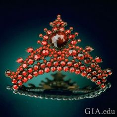"""This #Victorian-era pyrope hair comb is one of the most famous pieces of #garnet jewelry. A large """"fiery-eyed"""" rose-cut garnet sits at the crest, much like a queen serenely surveying her court. The pyrope garnets that decorate it came from Bohemia (now the Czech Republic). Don't you think this hair comb would make a breathtaking statement? Courtesy: Chip Clark, @smithsonian Institution"""