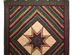 Feathered Star Trip Quilt. Great fabric selections and a wonderful design rarely made here. Excellent patchwork piecing and fine quilting. Made by local Amish woman.