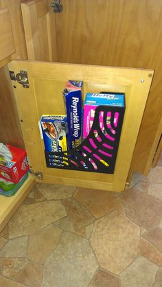Plastic magazine holder stuck to the inside of my kitchen cabinet with mounting tape! Freed up two shelves and a drawer!