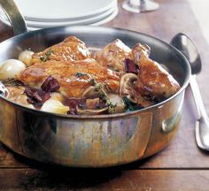 "One of the iconic dishes of France, coq au vin has its roots in the farmhouse cooking of Burgundy. It was originally made with the tough coq, or ""rooster,"" when he was past his prime. Long, slow co..."
