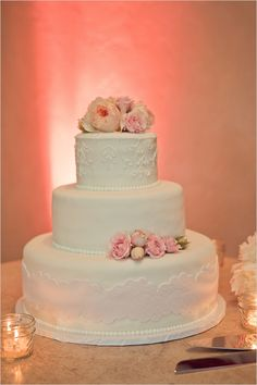 white on white and blush on white design cake with fresh flowers