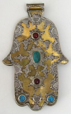 "Ornate double sided gilded silver hand of Fatima pendant. This is a Jewish mystical symbol called a hamsa or watchful hand. Note the stars of David with the ""watchful eye"" in the center. Fatima Hand, Cultura Judaica, Maxi Collar, Tribal Jewelry, Hamsa Jewelry, Hamsa Hand, All That Glitters, Evil Eye, Islamic Art"