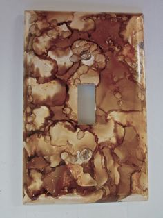 For sale on our PeakdancersArt easy site. Standard single switch wall plate by GE decorated with Alcohol Ink