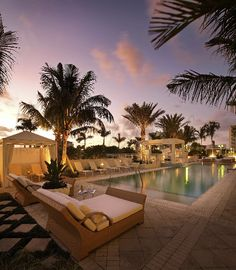 Palm trees, soft yellow lights, nice lounge chairs, checkered marble floors