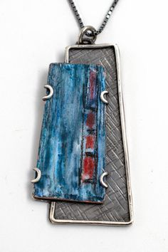 #Silvernecklace #Contemporaryjewelry #Silverpendant #colorednecklace #bluependant #pencilsonsilver #enamel #handmadejewelry #womensfashion #womensstyle #coloredsilver #coloredcopper