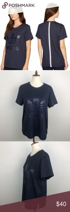 """Adidas Rare Blue Large White Stripe Trefoil Tee Short sleeve tee shirt by Adidas Blue with large white graphic stripe along the back Large trefoil print along the front Shirt is made of quality fabric and has a vertical ribbed texture Small slits along the side  Size UK 12 (approx size M US) Has a slight oversized, relaxed fit   Approx measurements  Armpit to armpit: 21"""" Length from shoulder: 28""""  Excellent preowned condition  ——- 00F211CL40 / EPM adidas Tops Tees - Short Sleeve"""