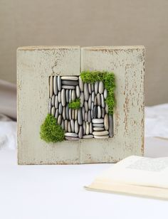 Own an original  unique wood and pebbles  wall hanging! This rustic decoration is completed by real preserved moss. It's nice to have a bit of natural serenity to enjoy anywhere, any time: at home, office or dorm, and they make lovely gifts for all occasions.   Makes a unique gift for friends and loved ones, enriching any indoor space.  #mosswallart #coastalwallart #lakehouseart #summerbohodecor #seapebblesframe #pebblewalldecor #pebblespicture #rusticwoodenframe #seasideroomdecor Boho Decor, Rustic Decor, Farmhouse Decor, Dried Flower Bouquet, Dried Flowers, Moss Wall Art, Coastal Wall Art, Candle Centerpieces, Wreaths For Front Door