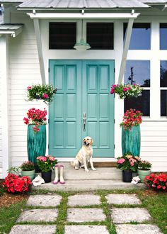 Welcoming entryway with blue door and barnlight