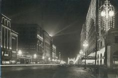 "Twelfth Street south to Market Street, showing lighting and triumphal arch for Thomas Edison for celebration of ""Light's Golden Jubilee,"" 22 October 1929. Give the gift of a beautiful historical print from the Missouri History Museum's photos and prints collection. Framed prints starting at $29.95. Browse our collections search for more: http://collections.mohistory.org/search/"