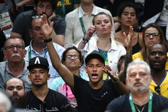Neymar Photos Photos - Brazilian football players, Gabriel Jesus and Neymar watch the Men's Gold Medal Match between Italy and Brazil on Day 16 of the Rio 2016 Olympic Games at Maracanazinho on August 21, 2016 in Rio de Janeiro, Brazil. - Volleyball - Olympics: Day 16