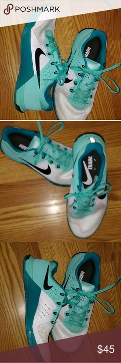 Nike Flywire Metcon Sneakers Great condition Has one small worn spot on one shoe not noticeable when wearing as it is on the inside. Shown in 5th pic Very comfortable Super cute shoes Turquoise in color Nike Shoes Sneakers