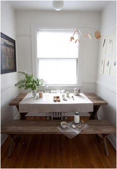 Picnic dining table- might be a cool idea for my vintage kitchen, if I can find an old one like this.