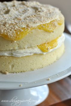 Homemade Lemon Cake with a layer of creamy lemon frosting and fresh lemon curd #cakerecipe #lemon @Shugary Sweets