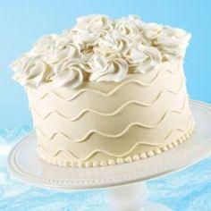 buttercream icing & cake recipe White Rosette flowers on top.