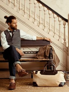 Not one for beards but he's rockin' it. Beard + ponytail + vest + Ernest Alexander weekend bag ... lovely!