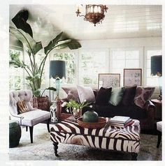 Wild Thing Wednesdays - This zebra ottoman really brings the room together!