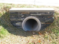 far left culvert made with thinly-stacked stones topped with single slate on these homes in south Raleigh, North Carolina
