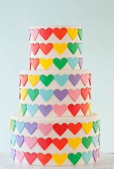 Rainbow Hearts~   Colorful fondant hearts are affixed to the cake tiers creating a whimsical and modern confection.