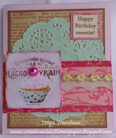 """Happy Birthday Sweetie  Hi everyone! It's me Tonya and I am here to share my card I created for this month's birthday theme challenge.I have been really into pastel colors lately and decided I would start with a pink piece of 8 1/2"""" x 5"""" which I folded in half to create the cardbase. I cut a piece kraft and printed cardstocks slightlysmaller than the front and inked all the edgesbefore adhering to the base of the card.  Next I glued a mint green doily to the base along three scraps of…"""