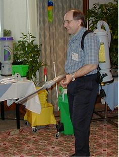 Alan Hedge, director of Cornell's Human Factors and Ergonomics Laboratory, demonstrates the use of a new lightweight backpack vacuum cleaner, among other floor cleaning equipment. Backpack Vacuum, Lightweight Backpack, Cleaning Equipment, Floor Cleaning, Flooring, Factors, Wood Flooring, Floor