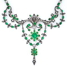 "Antique Colombian Gem Emerald and Diamond Necklace  ""Victorian-era emerald and diamond necklace finely crafted in silver over gold and gleaming with 89 small cushion-shape emeralds weighing 7.00 carats and 192 tiny antique-cut diamonds."" The central emerald is 1.87 ct."