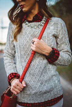 Stay stylish & warm in a cable knit sweater layered over a classic plaid shirt. Add a statement necklace with some sparkle to top off the look. It looks great paired with jeans for a more casual look as well as dressed up with a pencil skirt.
