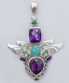 Gem Stone Energy Descriptions:  Gaia: Clear channel for earth magic,  Amethyst: Creativity & Spiritual Strength,  Green Quartz: Release of fear,  Turquoise: Protection & Release of Negativity,  Double Wings: Within Partnership,  Sterling Silver Gemstone Pendant.