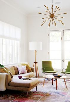 love this couch and carpet. nice accent chairs. interesting lamps.