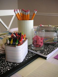 Writing paper covered tins...might be cute for a writing center.