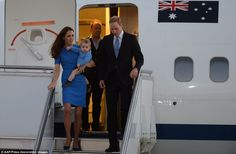 A royal entrance: Kate, William and George stepped off the plane in unison as they arrived in the capital