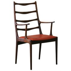 Vintage Danish Rosewood Tall Back Accent Chair | From a unique collection of antique and modern armchairs at https://www.1stdibs.com/furniture/seating/armchairs/